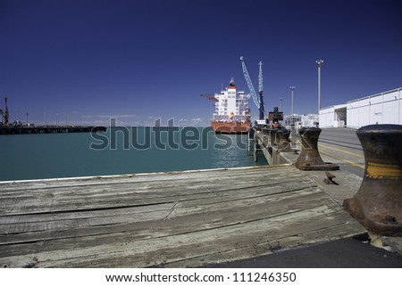 Container vessel berthed in New Plymouth container terminal. New Zealand, North Island. - stock photo