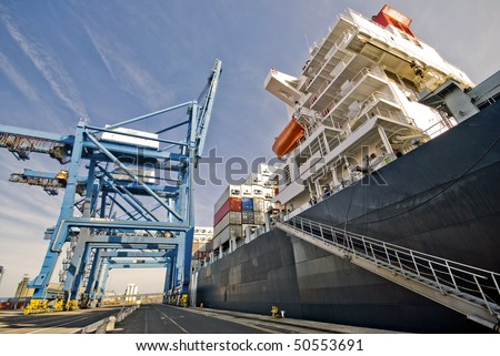 container vessel moored in the port, no trademarks visible - stock photo