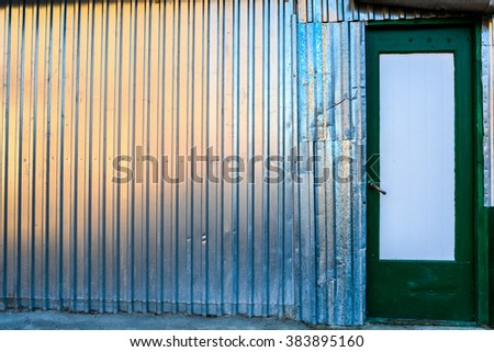container with green wooden doors