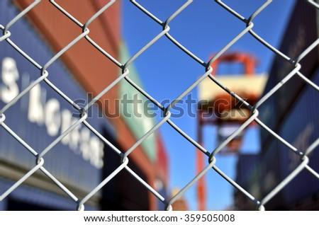 container yard security fence  - stock photo