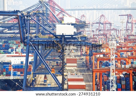 Containers at Hong Kong commercial port at day - stock photo