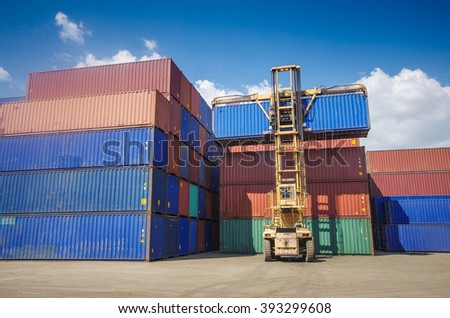 Containers box shifting within container yard - stock photo