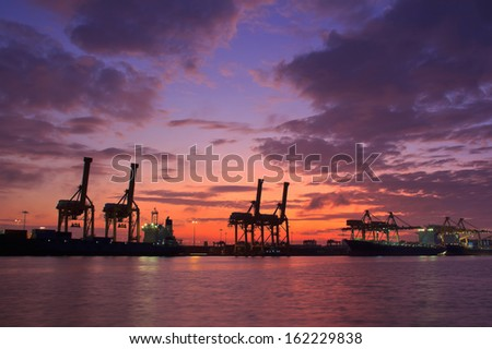 Containers loading at sea trading port - stock photo