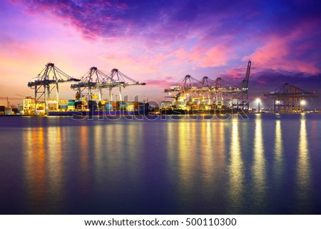 Containers loading by crane in the evening trade port shipping, Shipping and logistic concept