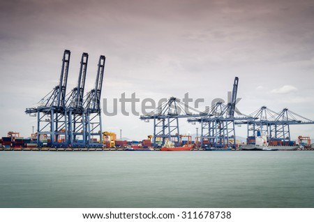 Containers loading by crane in the morning , Trade Port , Shipping