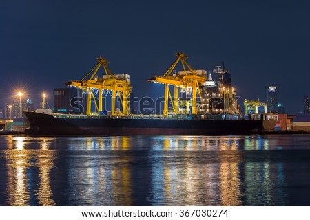 Containers loading by crane in the night , Trade Port , Shipping - stock photo