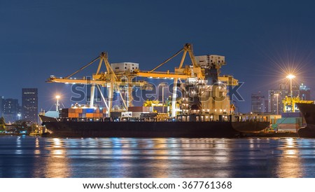 Containers loading by crane in the night , Trade Port , Shipping
