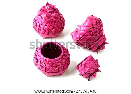 Containers made of woven palm leaves. - stock photo