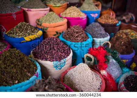 Containers of herbs for sale in the souks of Marrakesh - stock photo