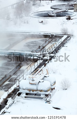 Containers of sulfuric acid in the wastewater treatment plant - stock photo