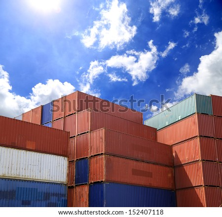 Containers shipping in yard with blue sky - stock photo
