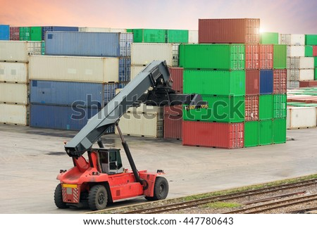 containers stacked in port with container handler