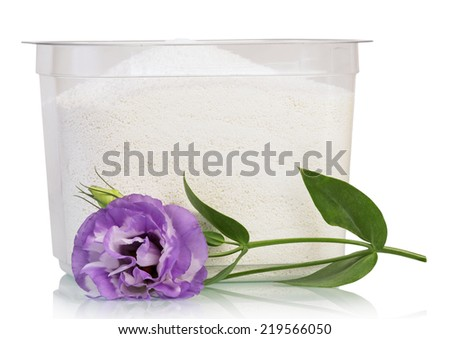 Containers with Washing powder and flower isolated on white - stock photo