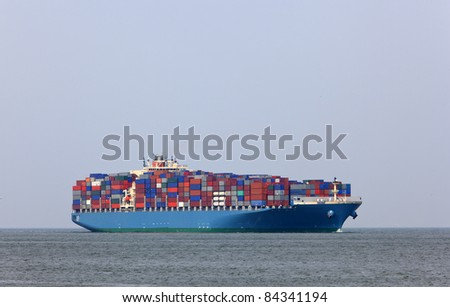 containership entering the harbour of rotterdam - stock photo