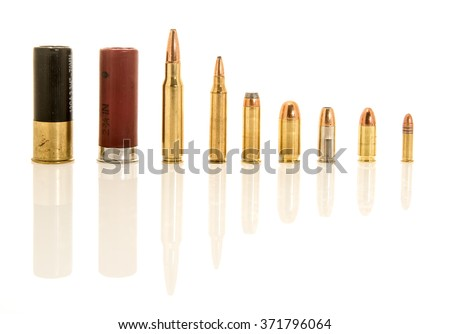 Containing both shotgun shells, rifle and handgun bullets in different calibers. Included  12 gauge, .308 or 7.62mm NATO, .223 or 5.56mm NATO, .45, .38 special, 9mm hollow point, 9mm, .22 long rifle. - stock photo