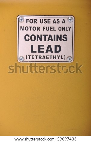 contains lead vintage sign on a yellow gas pump background