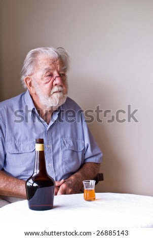 Contemplative Senior Drinker with Facial Injuries