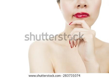 Contemplative woman hand on chin - stock photo