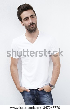 Contemplative young man in white t-shirt