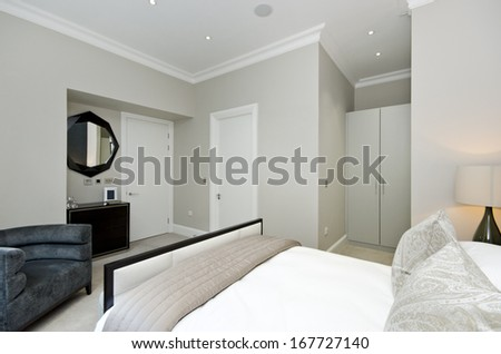 Contemporary and luxutious double bedroom with large bed and contemporary designer furniture
