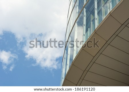 Contemporary Architecture with Sky and Cloud Reflection  - stock photo