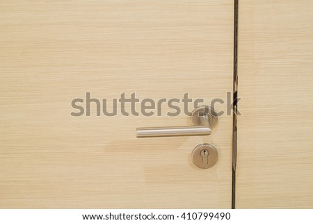 contemporary chrome door handle on hard wood door