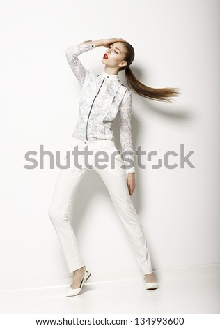 Contemporary Clothing Design. Modish Woman in White Blouse and Pants. Fashion - stock photo