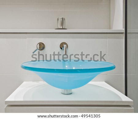 contemporary designer glass hand wash basin with chrome water tap