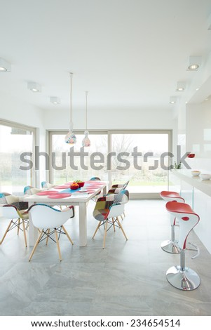 Contemporary dining room interior with designer chairs - stock photo