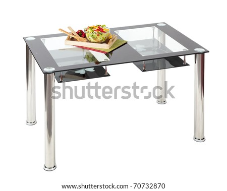 Contemporary dining table with glass top and under shelves - stock photo