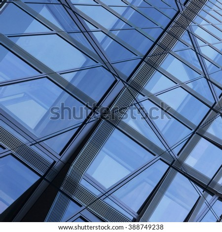 Contemporary glass architecture. Business cityscape. Smart double exposure photo of modern architectural fragment. Abstract hi-tech composition in shades of blue and gray colors. - stock photo