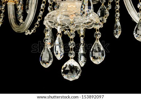 glass chandelier crystals isolated over black background