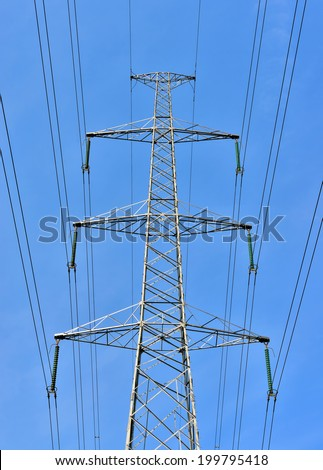 Contemporary high voltage electric pole on blue sky symmetric on the image - stock photo