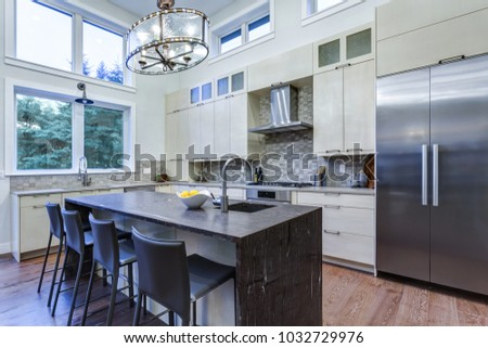 Contemporary Home Interior With Upscale Kitchen Appliances, Custom Built  Cabinets, Nice Island With Granite