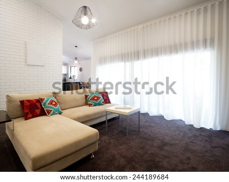 Contemporary home living room with sheer curtains - stock photo