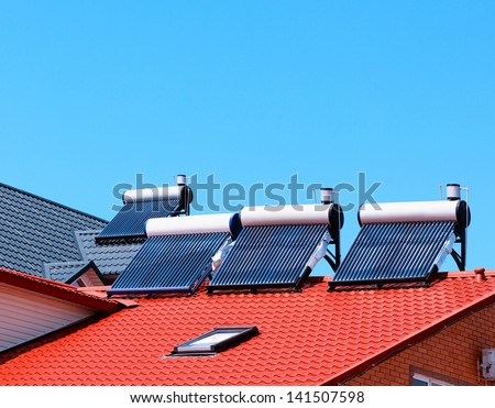 Contemporary hot water panels on a house - stock photo