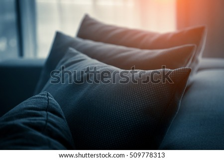 contemporary interior of Living room with part of sofa in sunny day and white curtain interior background concept vintage color tone