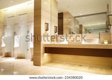 contemporary interior of public toilet - stock photo