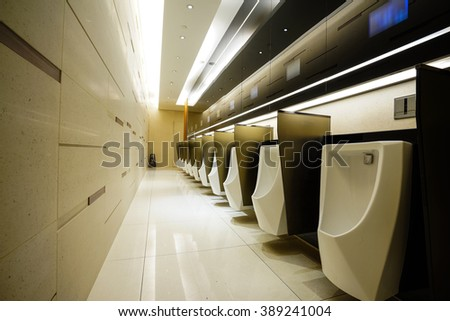 Contemporary interior of public toilet, part of the luxury hotel. - stock photo