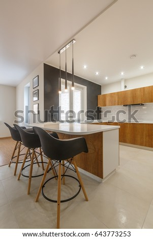 Contemporary kitchen in classical style with loft details. Luxury apartment downtown. Dining zone in comfortable brand new apartment.