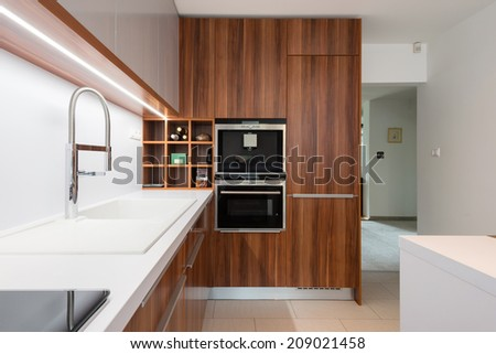 Contemporary kitchen interior in modern house - stock photo