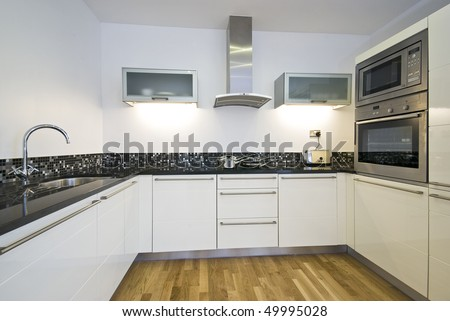 Contemporary kitchen with modern appliances in white - stock photo