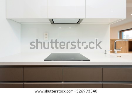 Contemporary kitchen worktop with induction cooker - stock photo