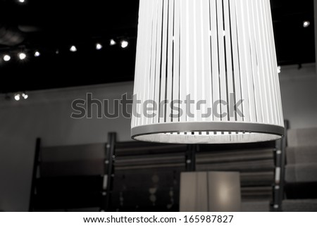 Contemporary lamp in show room of furniture store.