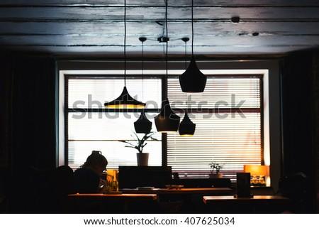 Contemporary lights illuminate the dark room - stock photo