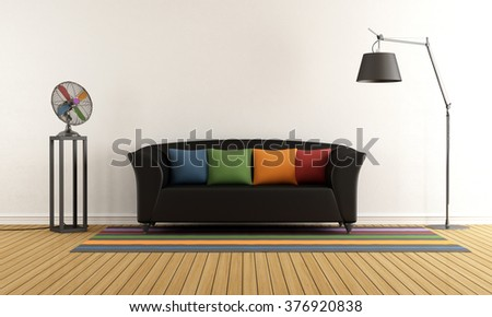 Contemporary living room with black couch,colorful cushions and electric fan - 3D Rendering