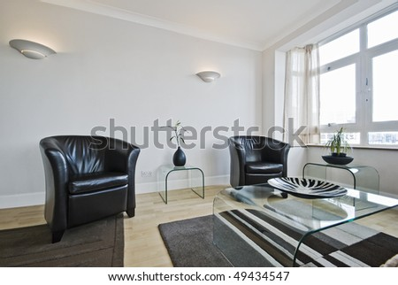 contemporary living room with modern leather armchairs - stock photo
