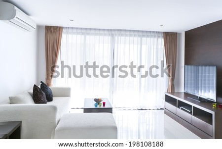 contemporary living room with sofa and television - stock photo