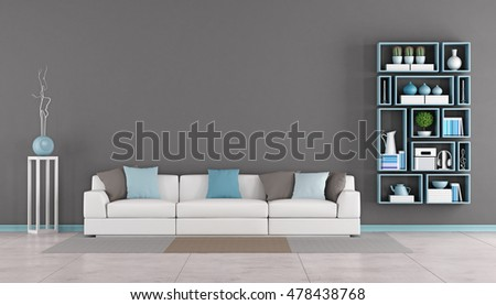 Contemporary living room with white sofa,colorful cushion and wall bookcase - 3d rendering