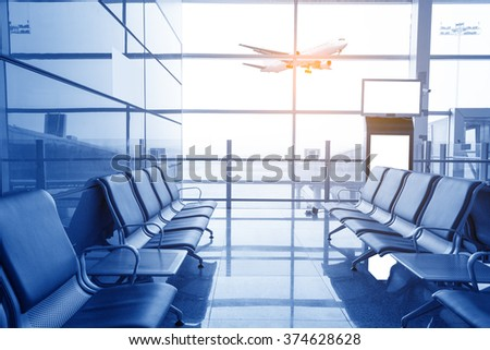 contemporary lounge with seats in the airport, blue tone - stock photo